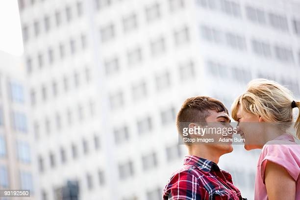A young affectionate couple in an urban setting