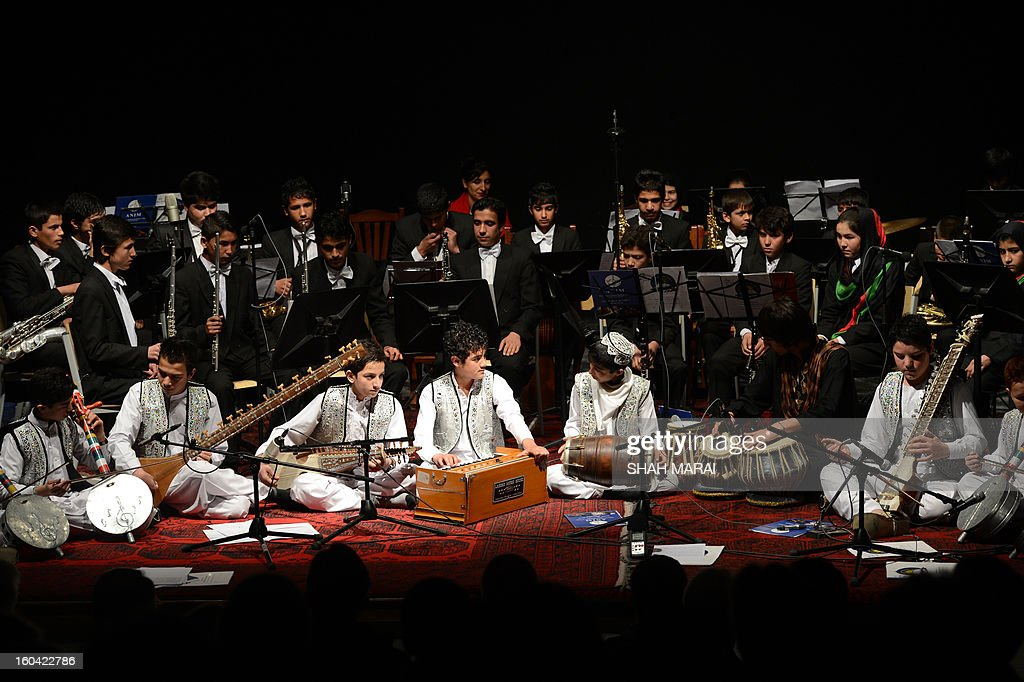 Young Afghan musician perform during a stage performance at French Culture Center (FCC) in Kabul on January 31, 2013. Afghanistan's youth orchestra flies to the United States on February 2 for a series of concerts highlighting changes in the war-torn country since the ousting of the Taliban, who banned music. Fifty students from the National Institute of Music and 12 faculty members will play at a series of venues, including New York's famed Carnegie Hall, the founder and director of the institute, Ahmad Sarmast, told AFP. AFP PHOTO/ SHAH Marai