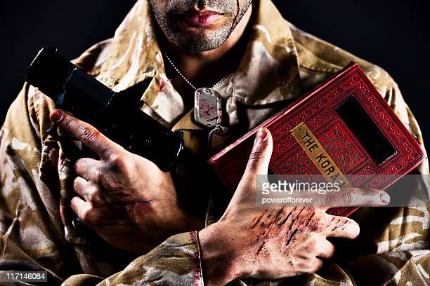 Young Afghan Soldier Holding Koran and Gun