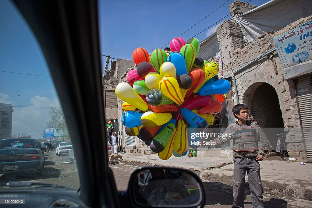 A young Afghan vendor sells balloons near the Sakhi shrine, which is the centre of the Afghanistan new year celebrations during the Nowruz festivities on March 21, 2013 in Kabul, Afghanistan. Nowruz is an ancient festival which marks the beginning of the spring equinox and the start of the year in the Iranian calendar, which this coming year will be 1392.