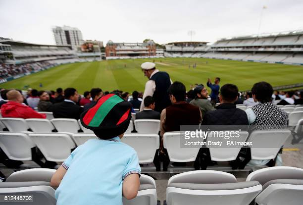 A young Afghanistan cricket fan watches from the stands during the one day match at Lord's London
