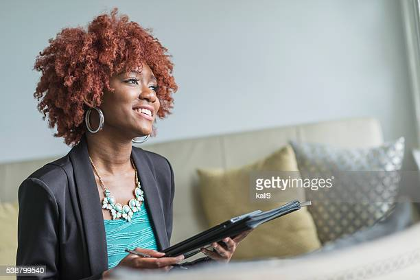 Young African American businesswoman with red afro