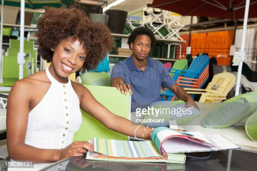 Young African American Couple Buying Outdoor Furniture At Store Stock Photo Getty Images
