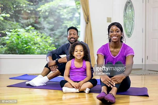 Young African American family smiling before exercising