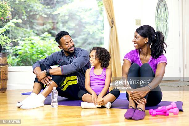 Young African American family talking after a home workout session