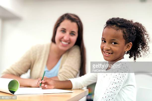 Young African American girl doing a writing exercise for therapy