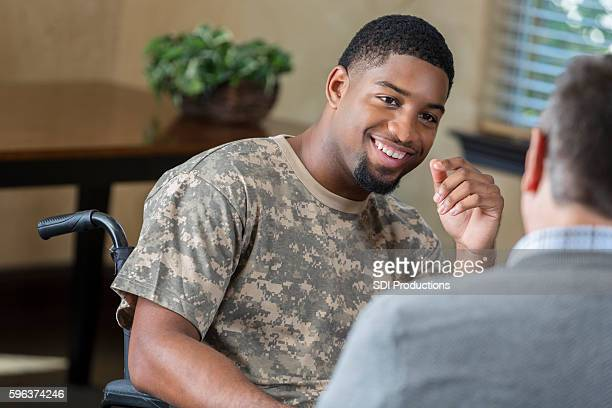Young African American soldier being assessed by military counselor
