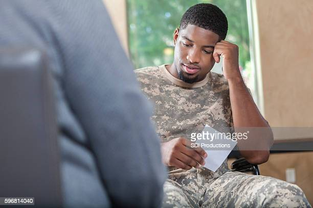 Young African American soldier talking to counselor about prescription