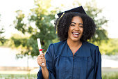 Happy young African American woman graduating.