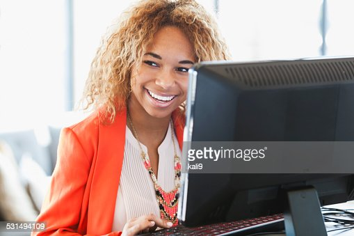 Young African American woman working on computer