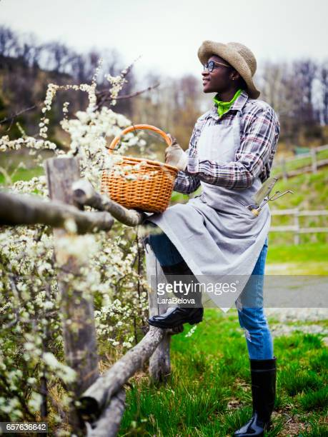 Young African farmer woman working in garden