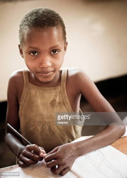 Young African Girl in an Orphanage doing Schoolwork