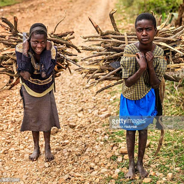 Young African girls carrying brushwood, southern Kenya, East Africa
