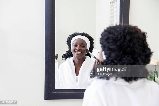 Young african teenaged girl applying makeup, Cape Town, South Africa