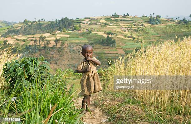 Young African tending to the fields among tall grass