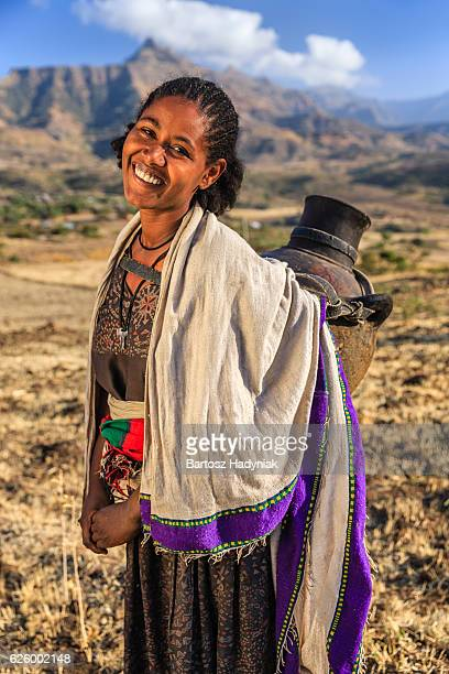 Young African woman carring jug of water, Ethiopia, Africa