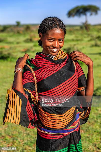 Young African woman carrying water from the well, Ethiopia, Africa