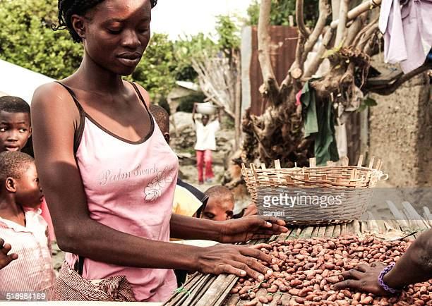 Young african woman selling nuts - Ghana, Africa