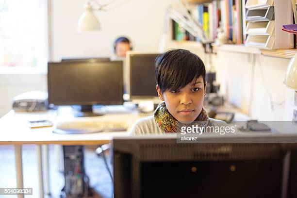 Young african woman working at a startup