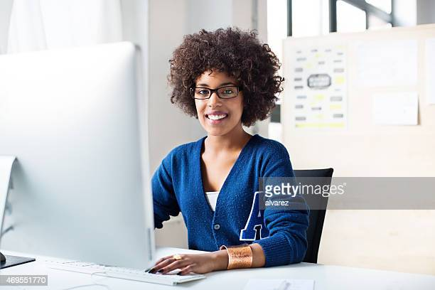 Young african woman working on computer