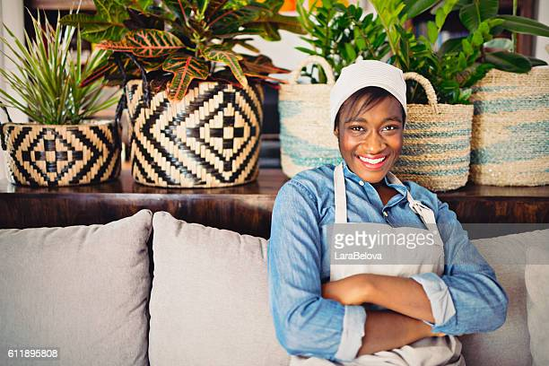 Young African women with her houseplants