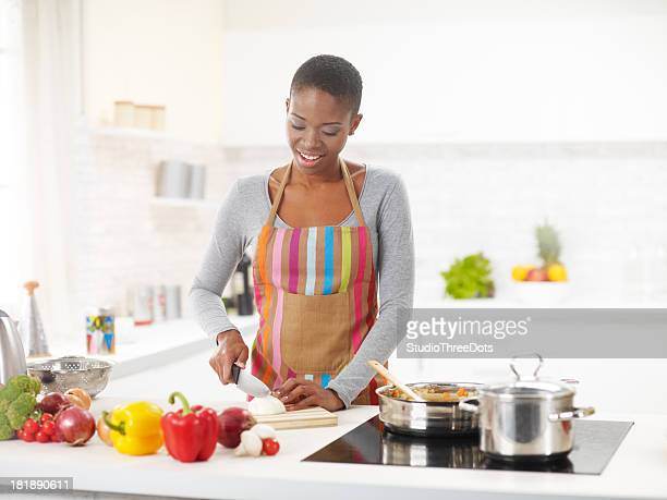 Young African-American Woman Preparing Delicious Lunch