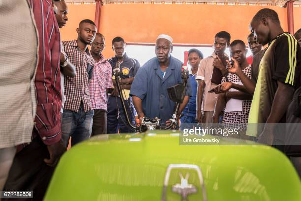 Young agricultural students and apprentices are told how to deal with a farm machine Innovation center in the CAPMatourkou agricultural school on...