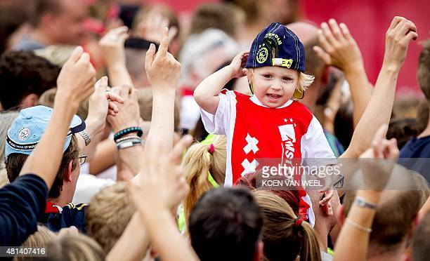 A young Ajax Amsterdam fan attends the team's presentation on an Open Day at the Amsterdam Arena in Amsterdam on July 20 2015 AFP PHOTO / ANP / KOEN...