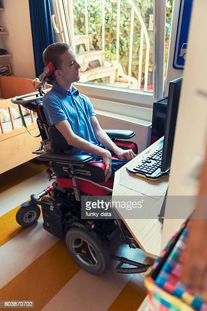 Young ALS patient gaming