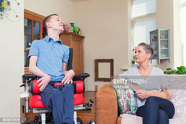 Young ALS patient with his mom