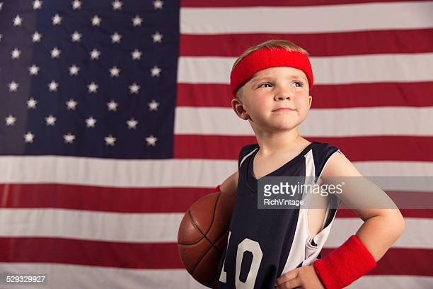 Young American Basketball Player in front of American Flag