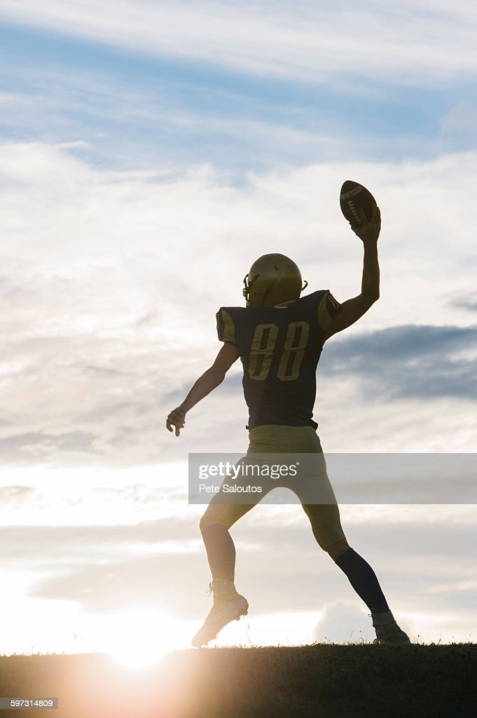 Young american football player about to throw ball