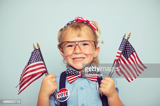 Young American Girl Holding Flags on Election Day