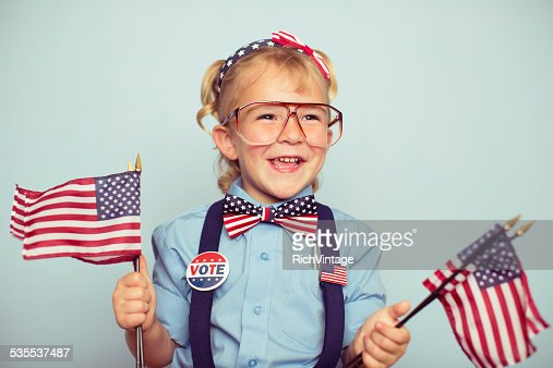 Young American Girl with American Flags