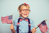 Little Girl with American Flags
