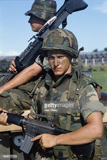 A young American Marine with an M16 rifle near St Georges during the US invasion of Grenada in Oct 1983