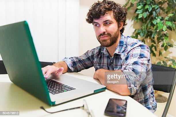 Young American Millennial Entrepreneur Working on Laptop Computer