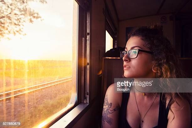 Young American Travels Thailand by Train at Sunrise