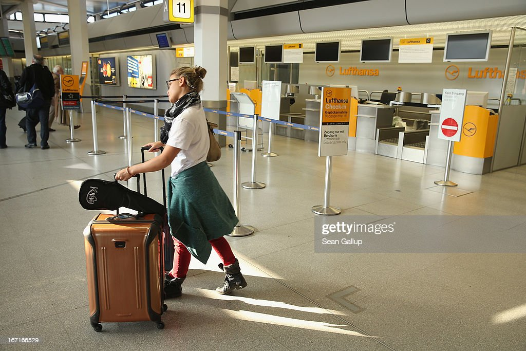A young American woman who was planning to tarvel to Venezuela walks past a closed Lufthansa check-in counter at Tegel Airport during a nationwide strike by Lufthansa ground, service and maintenance personnel on April 22, 2013 in Berlin, Germany. Workers are demanding pay raises and job guarantees and today's strike has forced Lufthansa to cancel approximately 1700 flights.