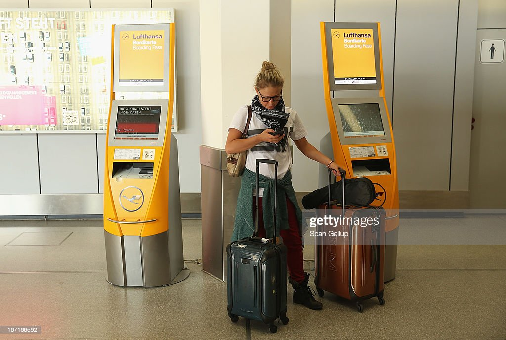A young American woman who was planning to travel to Venezuela on a Lufthnasa flight stands in front of Lufthansa check-in terminals at Tegel Airport during a nationwide strike by Lufthansa ground, service and maintenance personnel on April 22, 2013 in Berlin, Germany. Workers are demanding pay raises and job guarantees and today's strike has forced Lufthansa to cancel approximately 1700 flights.