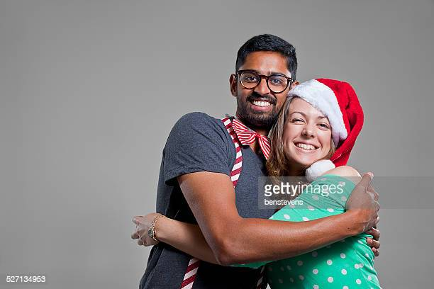 Young and attractive man and woman are friends at Christmas.