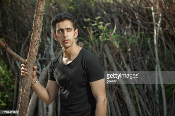 Young and attractive man in woods.
