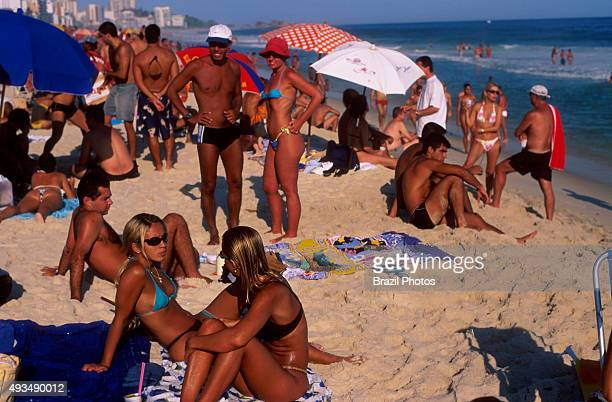 Young and beautiful people socialize at Ipanema beach on a suuny day Rio de Janeiro lifestyle Brazil