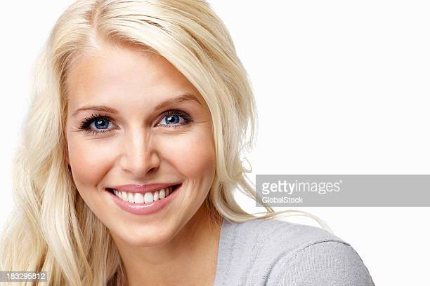 Young and beautiful woman smiling against white background