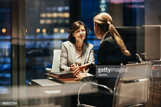 Young and Mature Business Woman Meeting Late