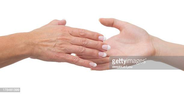 Young and mature hands on white