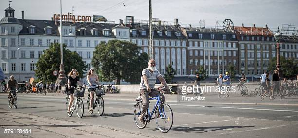 Young and old cyclists on Dronning Louises Bro, Copenhagen, Denmark