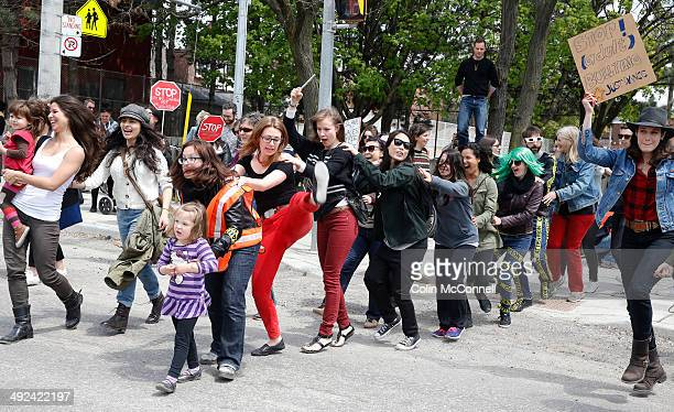 TORONTO ON MAY 18 Young and old dance the conga across the street Around 200 people showed up in support of Kathleen Byersthe dancing crossing guard...