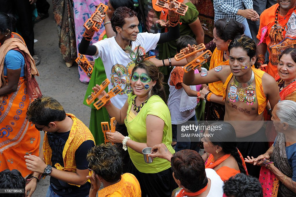 Young and old Indian devotees dance during the 136th Lord Jagannath Rath Yatra in Ahmedabad on July 10, 2013. According to mythology, the Rath Yatra dates back some 5,000 years when Hindu god Krishna, along with his older brother Balaram and sister Subhadra, were pulled on a chariot from Kurukshetra to Vrindavana by Krishna's devotees. AFP PHOTO / Sam PANTHAKY