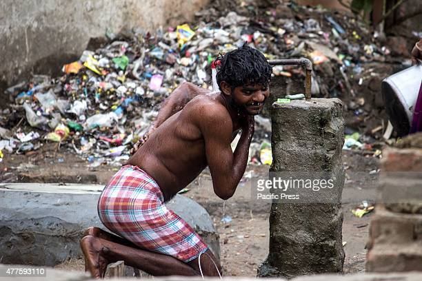 Young and old Indians take bathes under the heat of the sun India has been scorched by a heat wave in recent weeks that has claimed hundreds of lives...